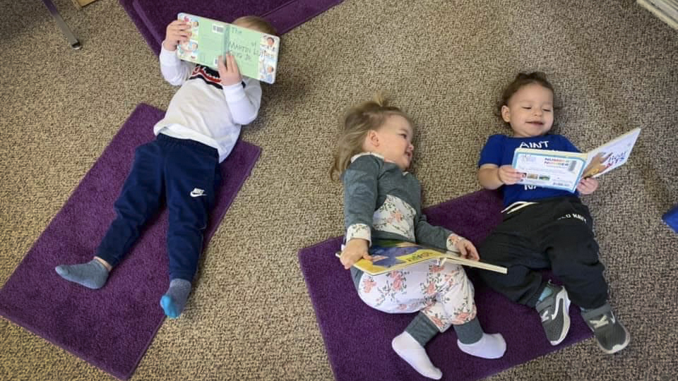 photo of kids reading in child care