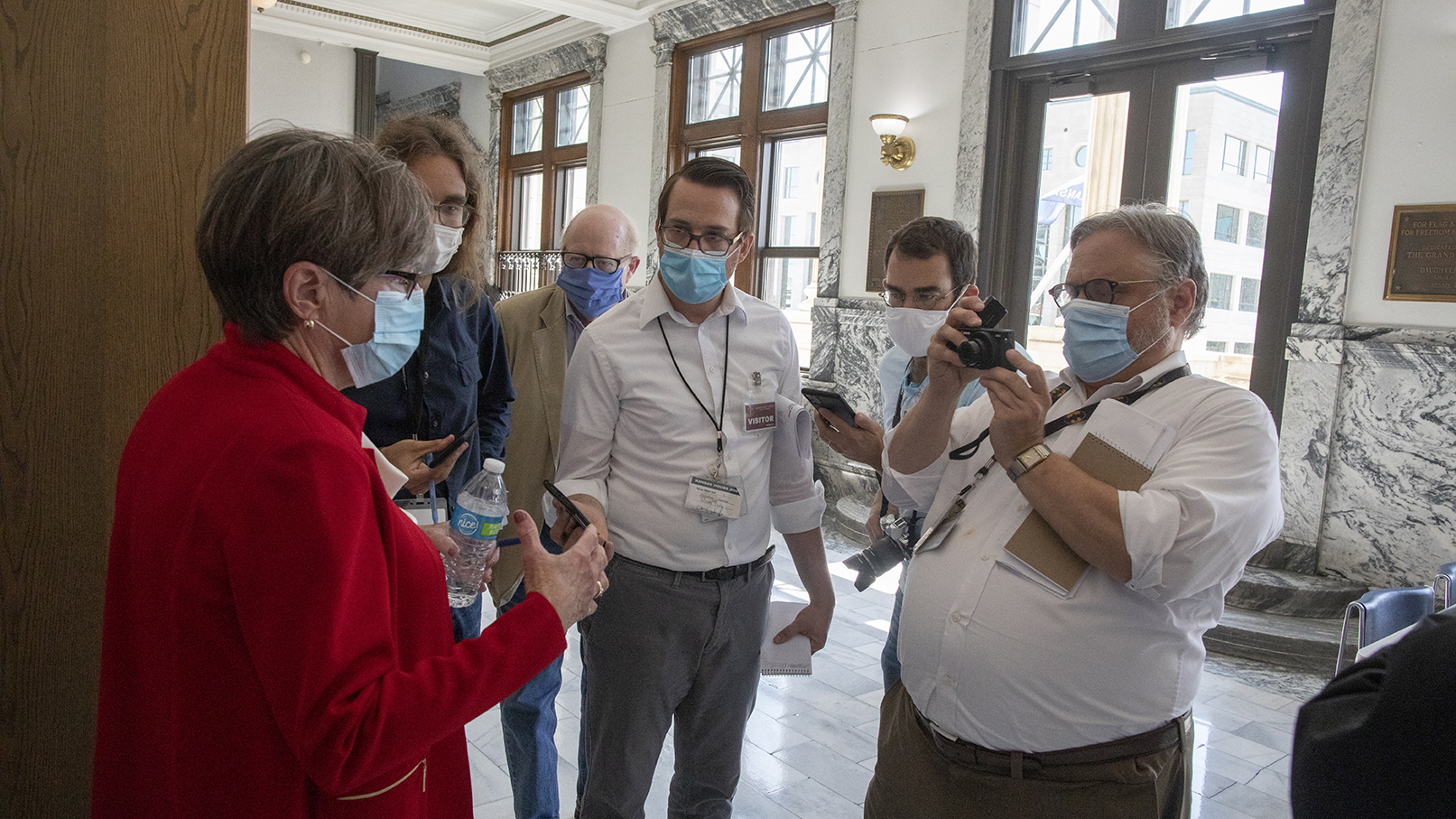 Kansas Gov. Laura Kelly with reporters during the pandemic